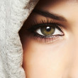 One eye.beautiful green eye of woman. girl in hood