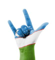 Hand making I love you sign, Uzbekistan flag painted