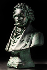 beethoven sculpture on black background