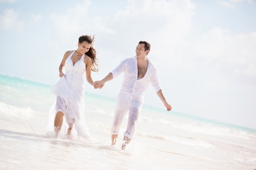 Newlywed Couple Running on a Tropical Beach