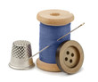 Spool of blue thread, needle, button  and thimble