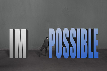 "Businessman push word ""impossible"" possible to separate, to make"