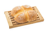 Four Buns Bread on Wooden Cutting Board over white