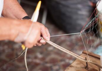 Man weaving a fishing net