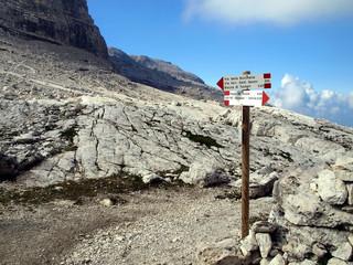 Marking the path Alfredo Benini in the Brenta Dolomites mountain