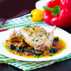 Ragout from stewed legs of rabbit with herbs, vegetables, olive