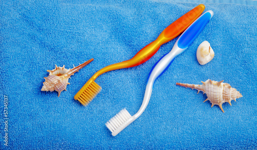 Pair of toothbrushes on blue towel