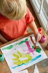 Young Child Painting Picture