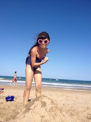 funny girl on beach