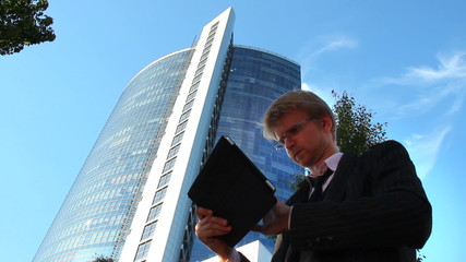 Business man stock broker checks index ratings, office building