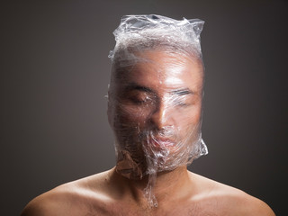 Man suffocating with plastic around his head
