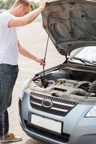 man opening car bonnet