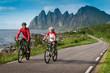 two cyclists relax biking