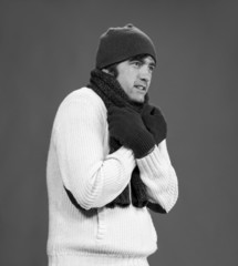 Handsome man in winter mittens, scarf and hat