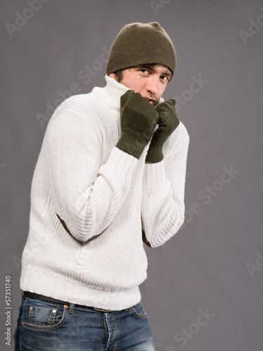 Man in winter mittens and hat