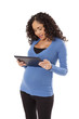 Pregnant woman uses a tablet computer.