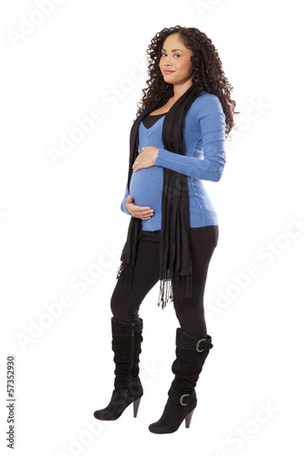 Pregnant woman in winter clothing.