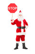 Full length portrait of a smiling Santa Claus holding stop sign