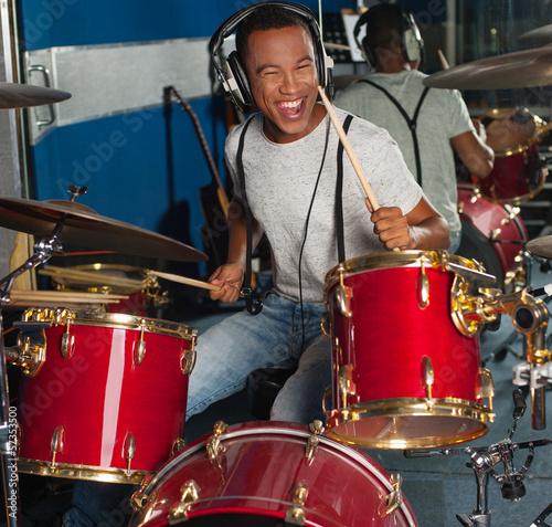 Drummer drifting away at the rhythm - 57353500