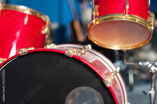 The red drum set inside studio