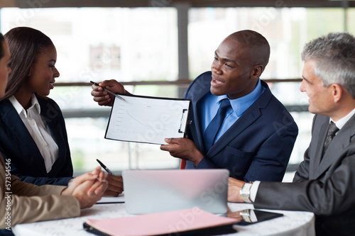 young african american businessman presenting figures at a meeti