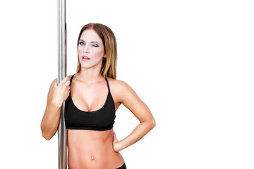 Sexy brunette pole dancer