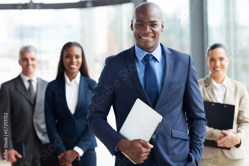 african businessman with group of businesspeople