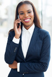 young african american businesswoman using cell phone