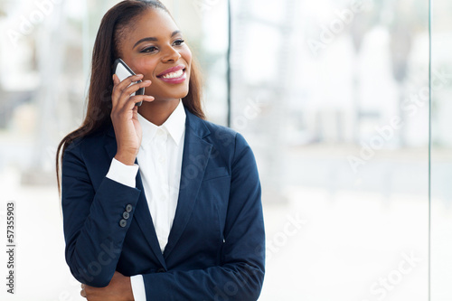 african businesswoman talking on mobile phone