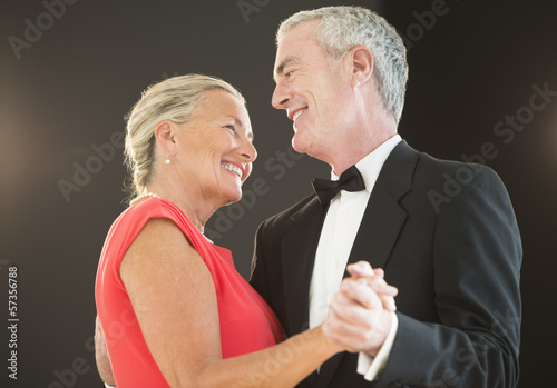 Couple Dancing Against Black Background