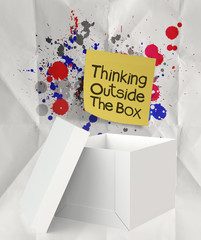 thinking outside the box and splash colors crumpled paper as con