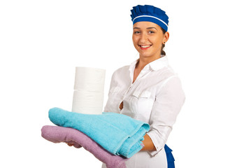 Maid holding towels and toilet paper