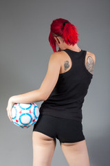 sexy girl with soccer ball from behind