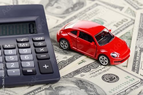 Car toy and calculator stay on the dollars