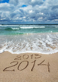 Happy New Year 2014 wash away 2013 concept on sea beach