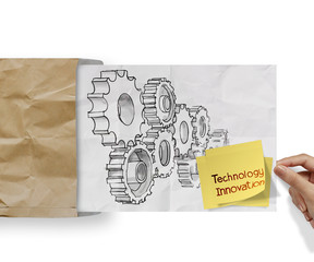 technology innovation sticky note with gear to success concept o