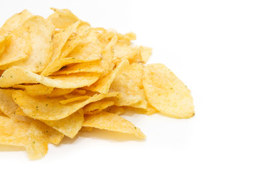 Close-up of salty potatoes chip on white background