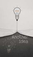 pencil lightbulb draw rope open wrinkled paper show another idea