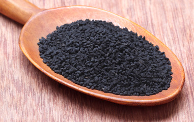 Nigella or Black cumin on a wooden spoon