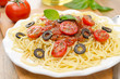spaghetti with tomato sauce, cherry tomatoes and olives