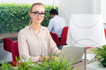 Woman in a hot desk office
