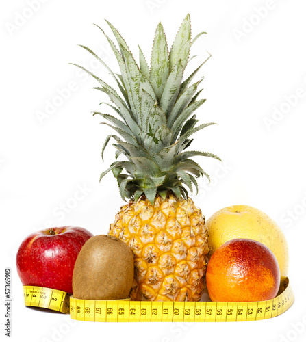 Fresh fruits with measuring tape isolated