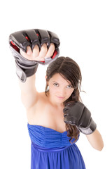 Young woman wearing boxing gloves in casual dress