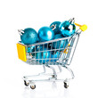Shopping cart full of christmas balls isolated on white backgrou
