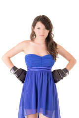 Woman in dress and boxing glove on white background,