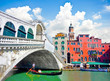 Famous Ponte di Rialto with Gondola in Venice, Italy