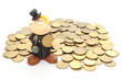 Chimney sweep on a pile of coins. Isolated on white