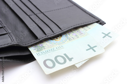 Closeup of money in wallet on white background