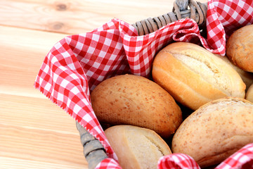 Fresh bread rolls in a rustic picnic basket