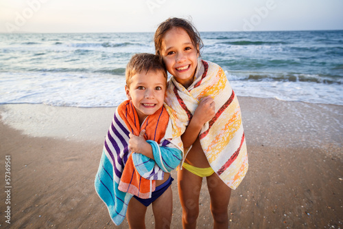 Two smiling kids on the beach